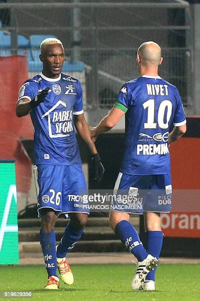 Troyes' Malian forward Adama Niane is congratulated by Troyes' French midfielder Benjamin Nivet after scoring a goal during the French L1 football...