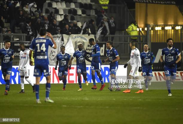 Troyes' Malian forward Adama Niane is congratuled by teamates after scoring during the French L1 football match between Amiens and Troyes on March 17...