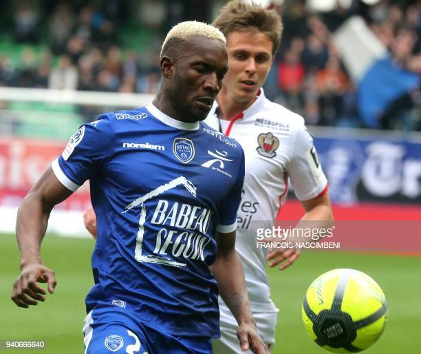 Troyes' Malian forward Adama Niane outruns Nice's French defender Arnaud Souquet during the French L1 football match between Troyes and Nice on April...