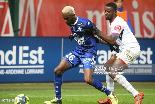 Troyes' Malian forward Adama Niane vies with Lille's defender Ibrahim Amadou during the French L1 football match between Troyes and Lille on January...