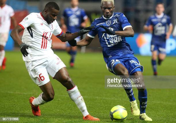 Troyes' Malian forward Adama Niane vies with Lille's midfielder Ibrahim Amadou during the French L1 football match between Troyes and Lille on...
