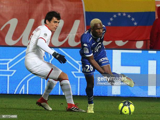 Troyes' Malian forward Adama Niane vies with Lille's Paraguay defender Junior Alonso during the French L1 football match between Troyes and Lille on...