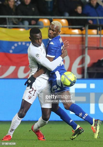 Troyes' Malian forward Adama Niane vies with Metz' French defender Moussa Niakhate during the French L1 football match between Troyes and Metz on...