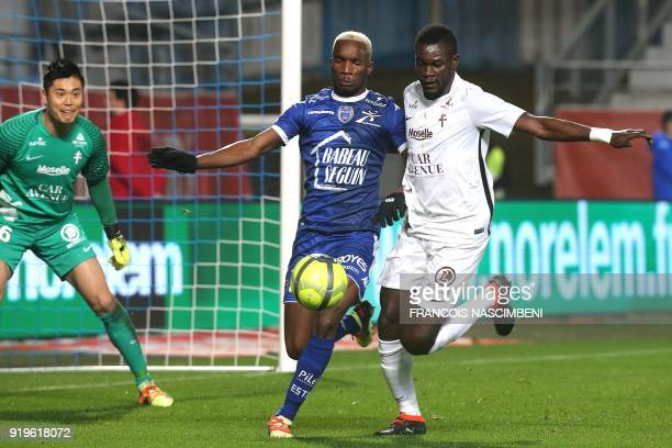 Troyes' Malian forward Adama Niane vies with Metz' Senegalese defender Fallou Diagne during the French L1 football match between Troyes and Metz on...