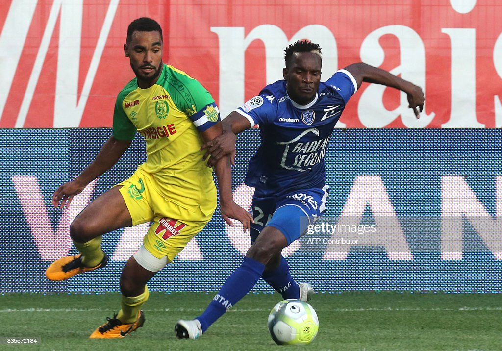 Troyes' Malian forward Adama Niane (R) vies with Nantes' French defender Koffi Djidji (L) during the French Ligue 1 football match between Troyes and Nantes on August 19, 2017 at the Aube stadium in Troyes. /