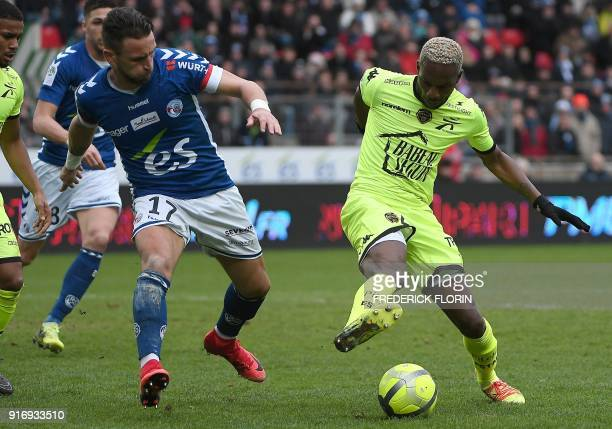 Troyes' Malian forward Adama Niane vies with Strasbourg's French midfielder Anthony Goncalves during the French L1 football match between Strasbourg...