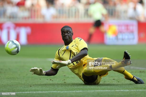 Troyes' Malian goalkeeper Mamadou Samassa stops the ball during the French L1 football match between Nice and Troyes on August 11 at the Allianz...