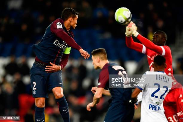 Troyes' Malian goalkeeper Mamadou Samassa stops the ball in front of Paris SaintGermain's Brazilian defender Thiago Silva during the French Ligue 1...
