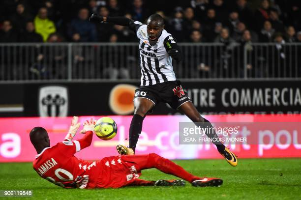 Troyes' MalianFrench goalkeeper Mamadou Samassa defends against Anger's Congolese midfielder Prince Oniangue during the French L1 Football match...