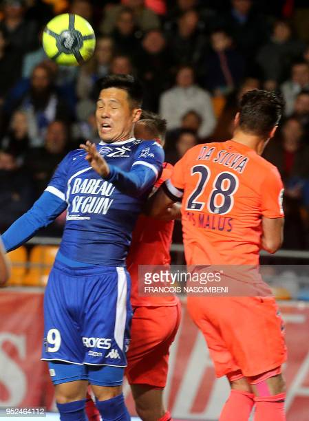 Troyes' NorthKorean forward Hyunjun Suk vies with Caen's French defender Damien Da Silva during the ball during the French Ligue 1 football match...