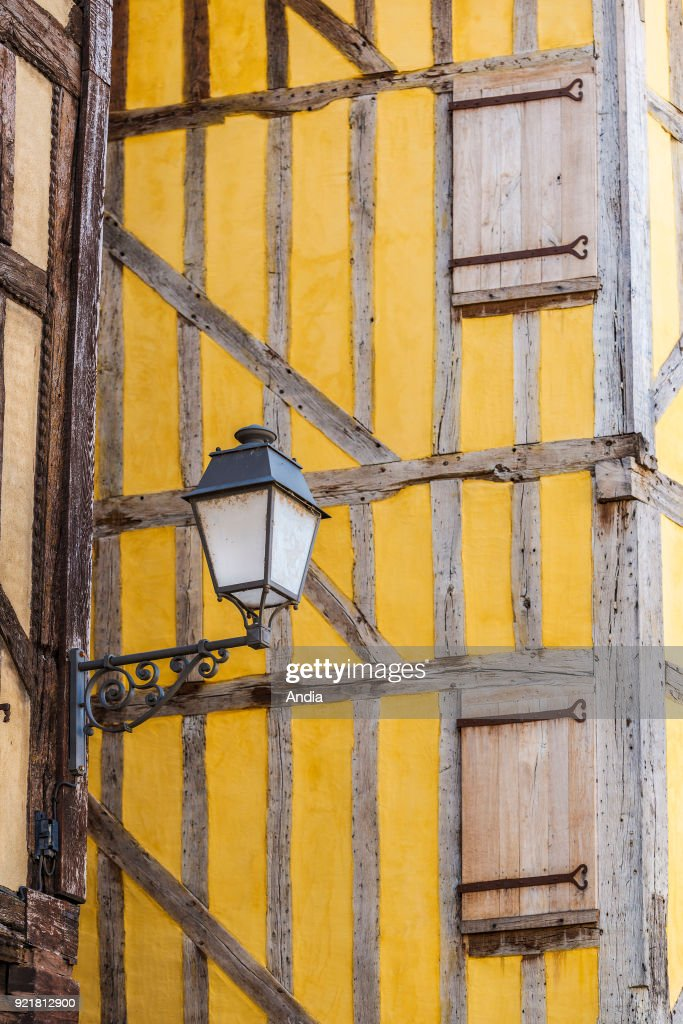 street lamp and yellow timber frame house.