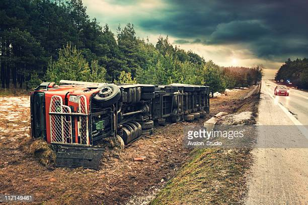 truck accident on slippery surfaces. - misfortune stock pictures, royalty-free photos & images