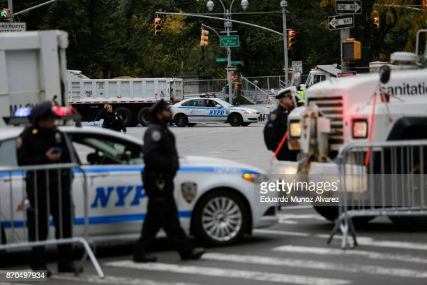 Truck and police cars are used as barricades while New York City Police officers stand guard before the start of the 2017 TCS New York City Marathon...
