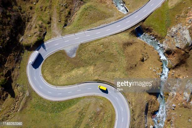 truck and van on winding, mountain road, aerial view - mountain road stock pictures, royalty-free photos & images