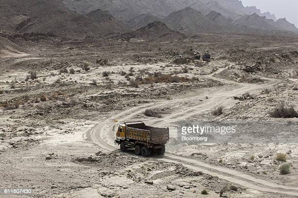 A truck arrives at a site where workers gather materials for the construction of the M8 motorway on the outskirts of Gwadar Balochistan Pakistan on...
