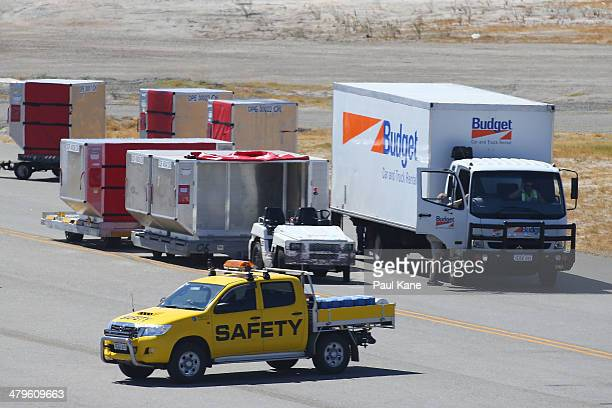 A truck arrives with luggage next to the Aeronexus Corporation's Boeing 767 used by the Rolling Stones while being prepared in readiness for takeoff...