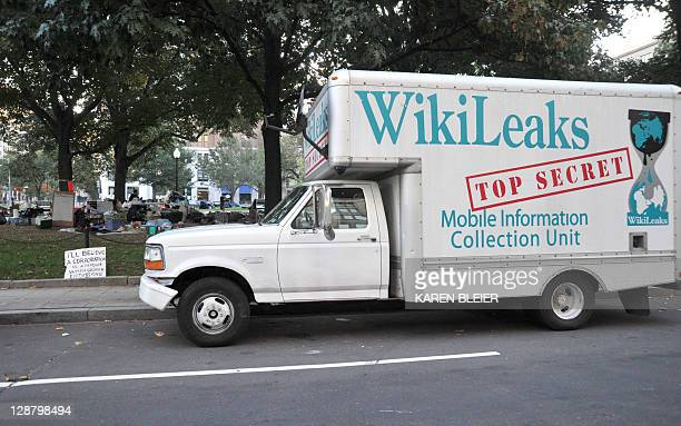 A truck bearing the WikiLeaks logo belonging to an Occupy DC demonstrator is parked on the street near a makeshift camp in McPherson Square October 9...
