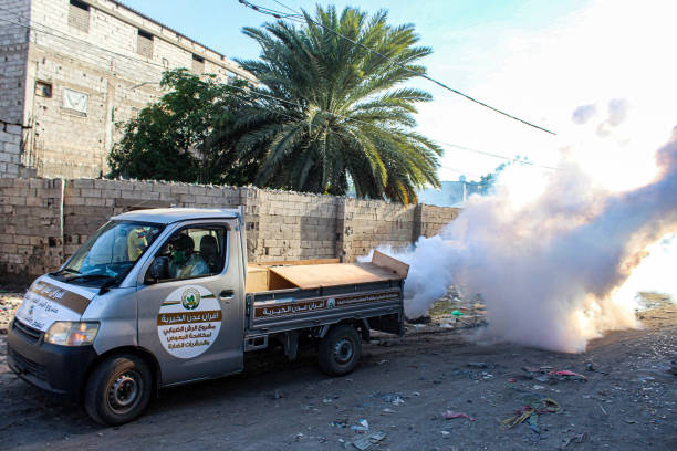 Truck belonging to a local charity carries out a fumigation in an area in Yemen's southern coastal city of Aden on May 3 as part of a campaign to...