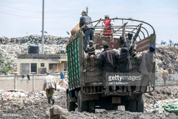 A truck brings new waste to the Dandora rubbish dump on March 14 2018 in Nairobi Kenya The Dandora landfield is located 8 Kilometer east of the city...