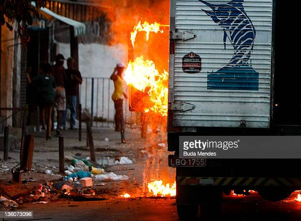 A truck burns in flames after being set fire by traffickers of the criminal organizations ADA and Comando Vermelho at Favela do Jacarezinho Zona...