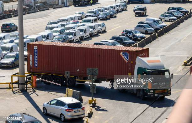 A truck carries a container outside TSA Santa Apolonia multipurpose container terminal on October 10 2019 in Lisbon Portugal Lisbon harbor is one of...