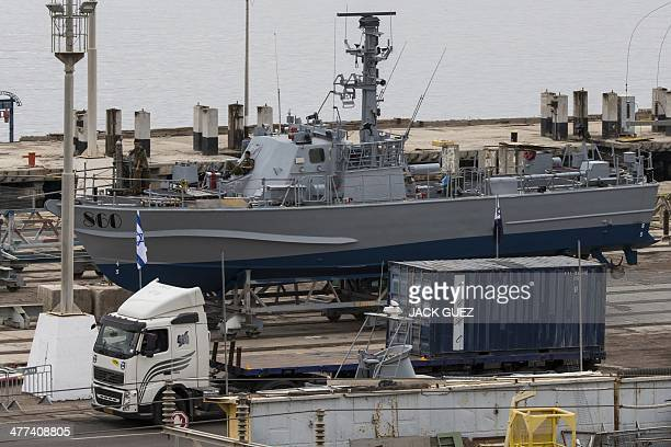 Truck carrying a container unloaded from the Panamanian-flagged Klos-C vessel arrives at a navy base on March 9, 2014 near the southern Israeli port...