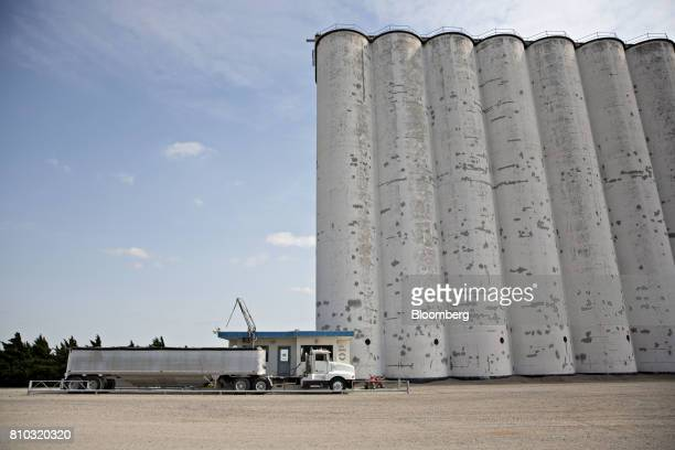 A truck carrying a delivery of hard red winter wheat sits on a scale at a grain elevator in Zurich Kansas US on Thursday June 29 2017 Spring wheat...