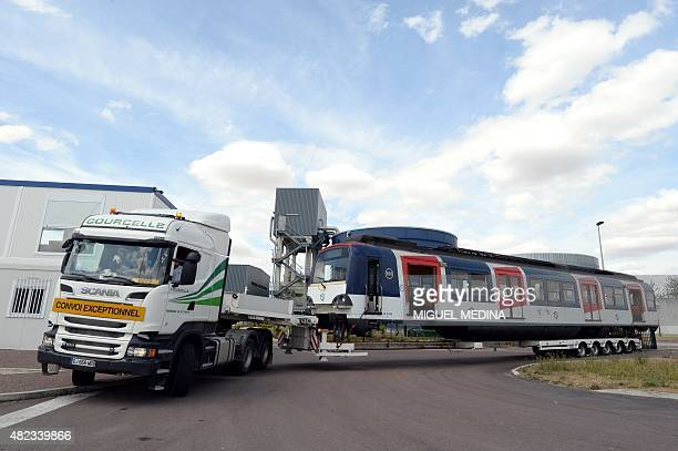 A truck carrying a former carriage of the Paris RER regional express railway line arrives in NogentsurSeine some 100 kilometers southeast of Paris on...