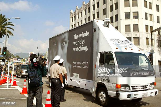 A truck carrying an antismoking billboard drives past the arrivals area on Hollywood Boulevard during preparations for the 77th Academy Awards at the...