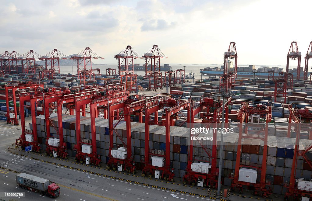 A truck carrying an A.P. Moeller-Maersk A/S shipping container drives through the Yangshan Deep Water Port, part of China (Shanghai) Pilot Free Trade Zone's Yangshan free trade port area, in Shanghai, China, on Wednesday, Oct. 23, 2013. The area is a testing ground for free-market policies that Premier Li Keqiang has signaled he may later implement more broadly in the world's second-largest economy. Photographer: Tomohiro Ohsumi/Bloomberg via Getty Images