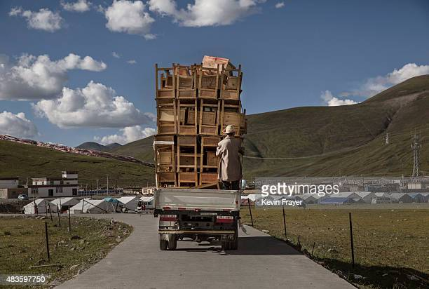 A truck carrying desks and chairs for Buddhist religious study drives fully loaded away from a Buddhist Monastery after a teaching on July 23 2015 on...