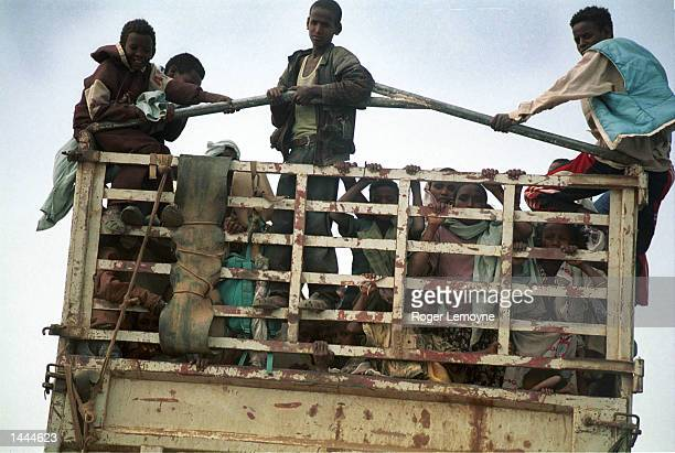 Truck carrying Eritreans displaced by the war heads, May 29, 2000 towards Dbarwe, about 40 km from the capital Asmara. A large refugee settlement of...