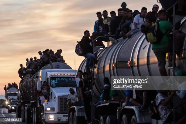 TOPSHOT A truck carrying mostly Honduran migrants taking part in a caravan heading to the US drives from Santiago Niltepec to Juchitan near the town...