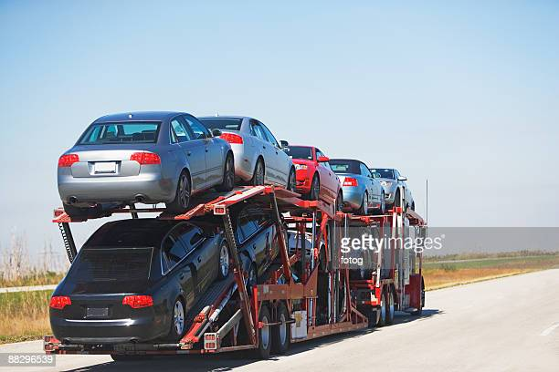 Truck carrying new cars