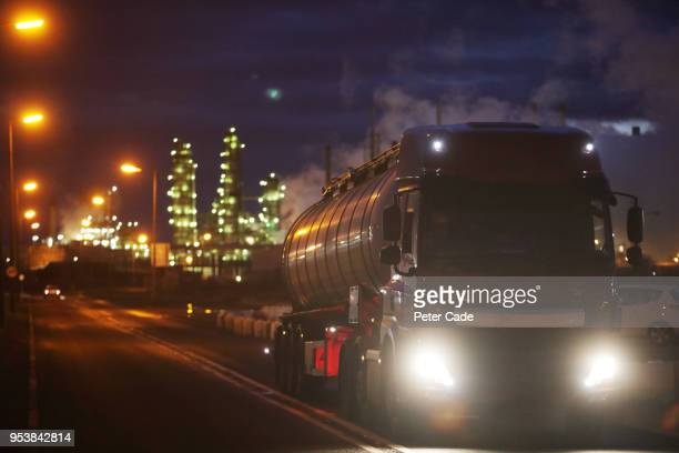 Truck carrying oil leaving refinery