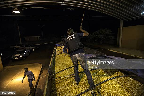 A truck carrying soybeans is inspected by Brazilian Tax Authority agents during an operation near the border with Paraguay in Foz do Iguacu Brazil on...