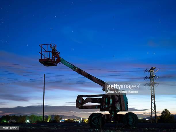 Truck, crane truck at dusk.