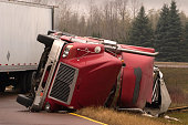 Truck crash with turned over semi
