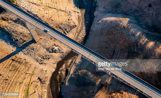 Truck crosses the Enterprise Bridge at Lake Oroville, which stands at 33 percent full and 40 percent of historical average when this photograph was...