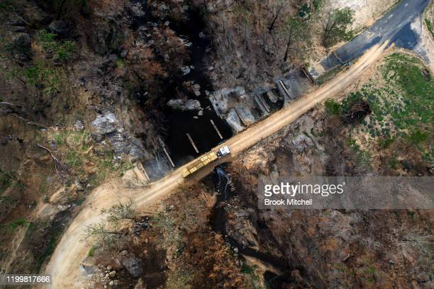 A truck crosses the temporary bridge over the Mann River in Wytaliba on January 14 2020 in Wytaliba Australia The bridge is the only way in and out...