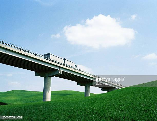 truck crossing elevated motorway section - 高架道路 ストックフォトと画像