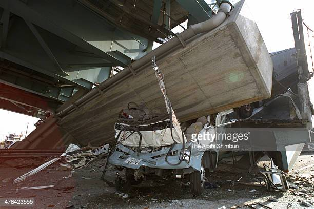 A truck crumpled as the collapsed elevated expressway struck on Janaury 17 1995 in Nishinomiya Hyogo Japan Magnitude 73 strong earthquake jolted in...