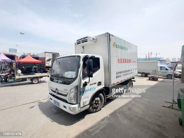 A truck delivering vegetables to Beijing sits parked at Hebei Xinfadi agriculture products wholesale market which belongs to Beijing Xinfadi Market...