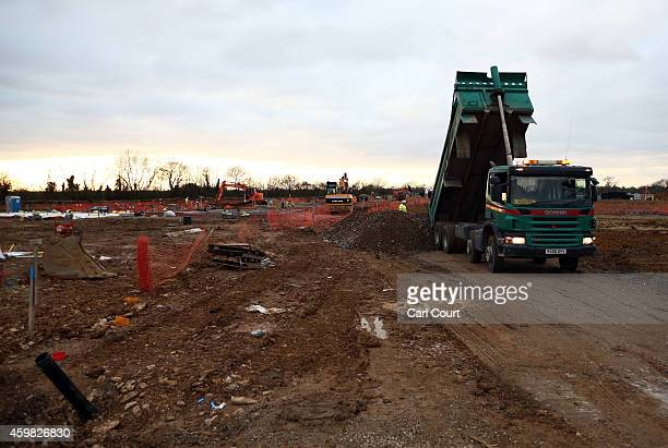 A truck delivers ballast at the site of the first ecotown in the United Kingdom on December 2 2014 in Bicester England Up to 13000 new homes are due...