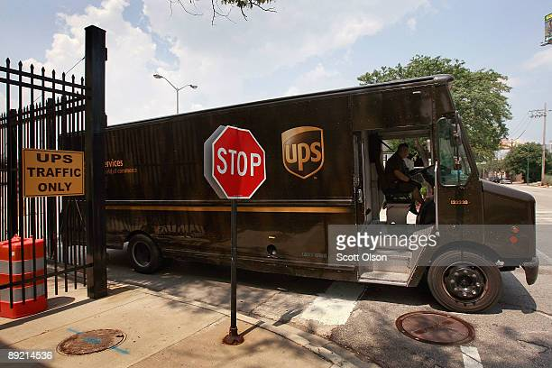 A truck departs a United Parcel Service Inc terminal July 23 2009 in Chicago Illinois UPS today reported secondquarter income fell 49% on continued...