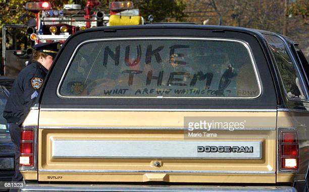 A truck driven near the crash site is decorated with the words 'Nuke Them' after American Airlines flight 587 carrying 255 people crashed minutes...