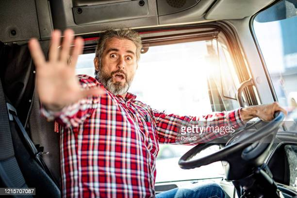 truck driver being attacked by a stranger. - violence stock pictures, royalty-free photos & images