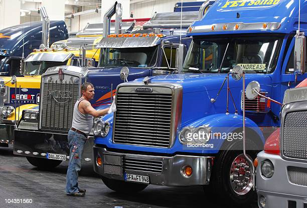 A truck driver cleans a Freightliner Coronado truck at the IAA Commercial Vehicles Show in Hanover Germany on Wednesday Sept 22 2010 Daimler AG said...