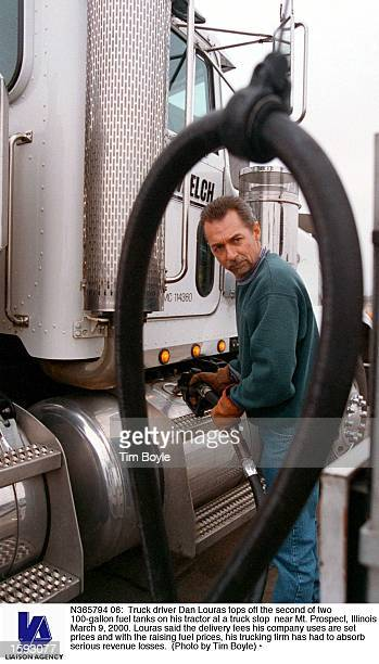 Truck driver Dan Louras tops off the second of two 100gallon fuel tanks on his tractor at a truck stop near Mt Prospect Illinois March 9 2000 Louras...