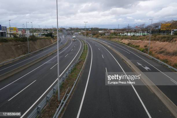 Truck driver drives his truck on the A7 motorway between Reus and Tarragona, being one of the groups allowed to travel because it is considered an...